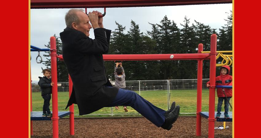Mr. Kelly, our Interim Principal, monkeying around on the playground.